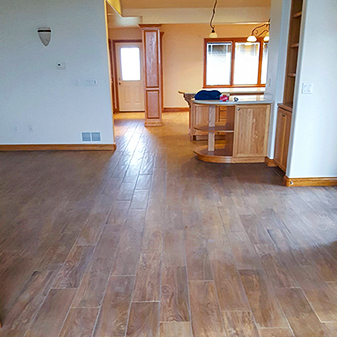Wood look tile projects by Carpet Masters of Longmont, Colorado